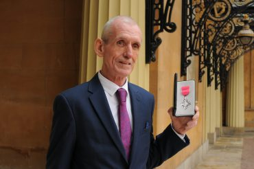 Dennis Rogers with his MBE medal