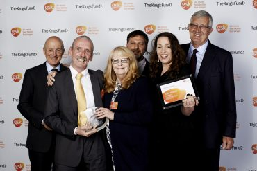 An image of Groundswell staff and volunteers winning the GSK impact award